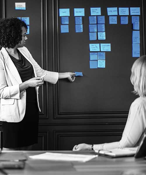 woman-presenting-meeting-with-post-its